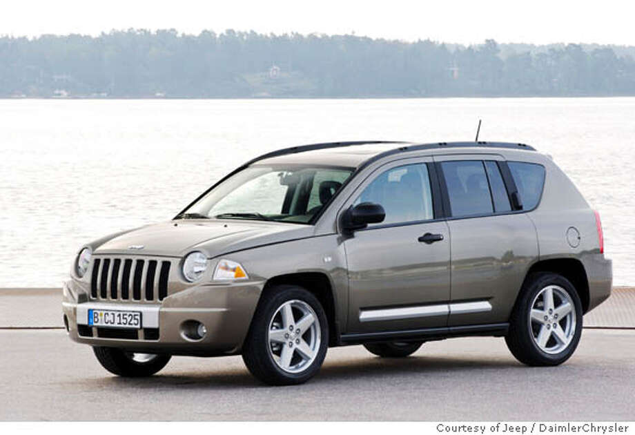 The 2007 Compass is faithful to Jeep's styling and its mix of spartan and luxury interior. The writer liked its unmistakable Jeep boxiness, grille and roofline. Photo courtesy of Jeep/DaimlerChrysler