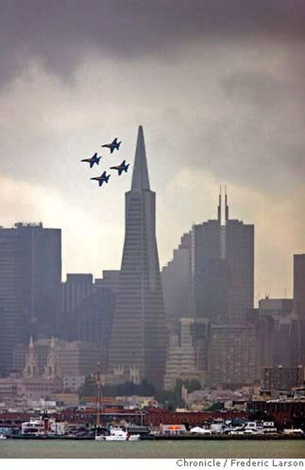 The Blue Angels fly over San Francisco in preparation for Fleet Week and for the 60th anniversary of the U.S. Navy's flight team. Chronicle photo by Frederic Larson