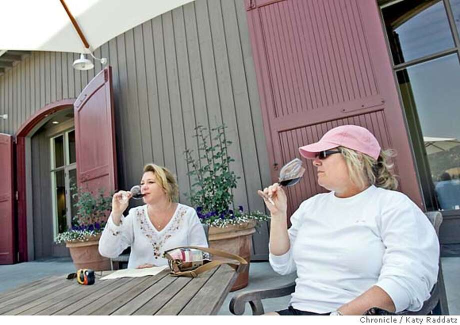 Jane Carpenter and Vana Lamont, visiting from Texas, enjoy the wine and weather outside the tasting room at Stonestreet Vineyards & Winery. Chronicle photo by Katy Raddatz