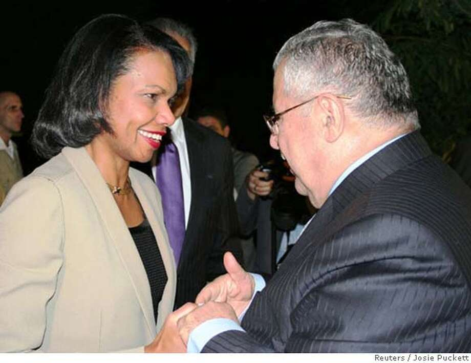 Condoleezza Rice greets Iraq President Jalal Talabani (right) at the fortified Green Zone in Baghdad. During her meeting with him, the lights went out, forcing Rice to continue the discussion in the dark. Reuters photo by Josie Puckett