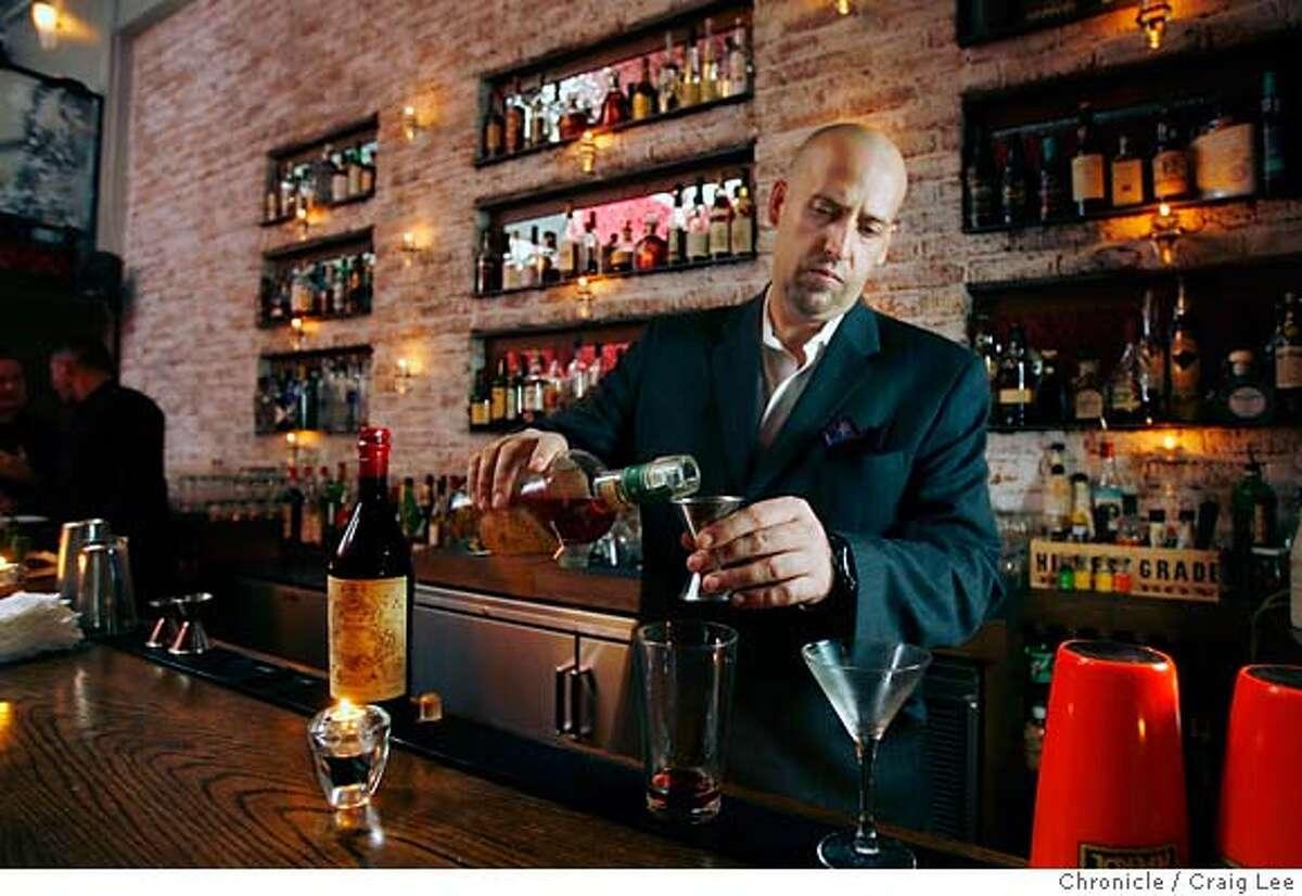 Bourbon & Branch bar director Todd Smith makes a Manhattan. Chronicle photo by Craig Lee
