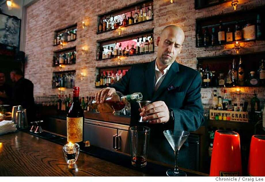 Bourbon & Branch bar director Todd Smith makes a Manhattan. Chronicle photo by Craig Lee