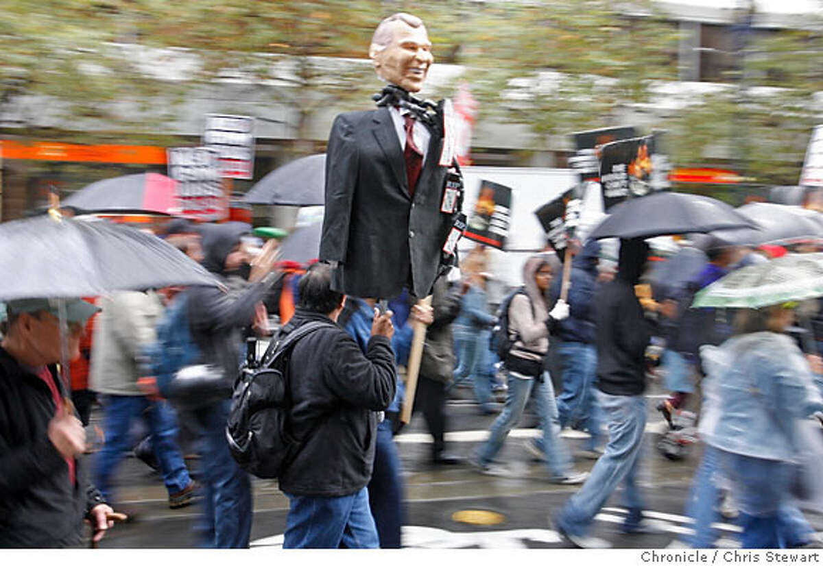 A protester carries an effigy of President Bush on Market Street. Chronicle photo by Chris Stewart