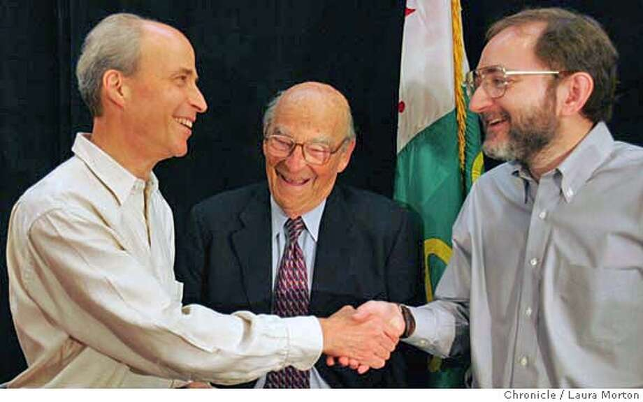 Andrew Fire (right) congratulates Roger Kornberg (left) after a press conference announcing Kornberg's win of the 2006 Nobel Prize in Chemistry on Wednesday morning at Stanford University. Fire was also honored this week as the winner of the 2006 Nobel Prize in Physiology or Medicine, which was announced on Monday. Roger Kornberg's father Arthur Kornberg (center) won the 1959 Nobel Prize in Physiology or Medicine. Photo: Laura Morton