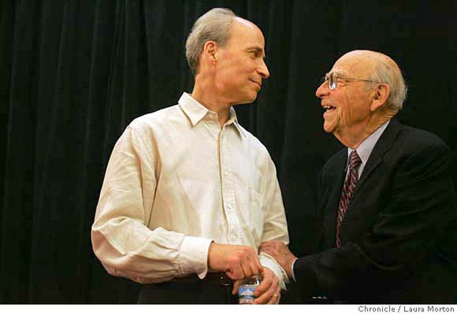 Roger Kornberg (left), of the Stanford University School of Medicine, speaks with his father Arthur Kornberg after a press conference to announce Roger Kornberg's win of the 2006 Nobel Prize in Chemistry. Arthur Kornberg won the Nobel Prize for Physiology or Medicine in 1956. Photo: Laura Morton