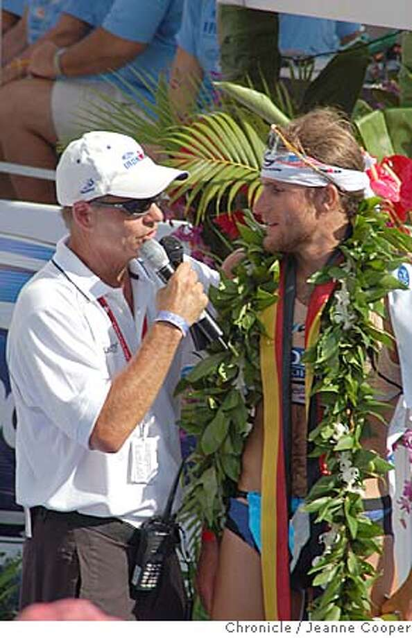 TRAVEL IRONMAN -- The winner of the 2005 Ford Ironman World Championship, Faris Al-Sultan of Germany, wears traditional Hawaiian victory leis of maile during his post-race interview. Kailua-Kona on 10/15/05. Jeanne Cooper / The Chronicle Photo: Jeanne Cooper