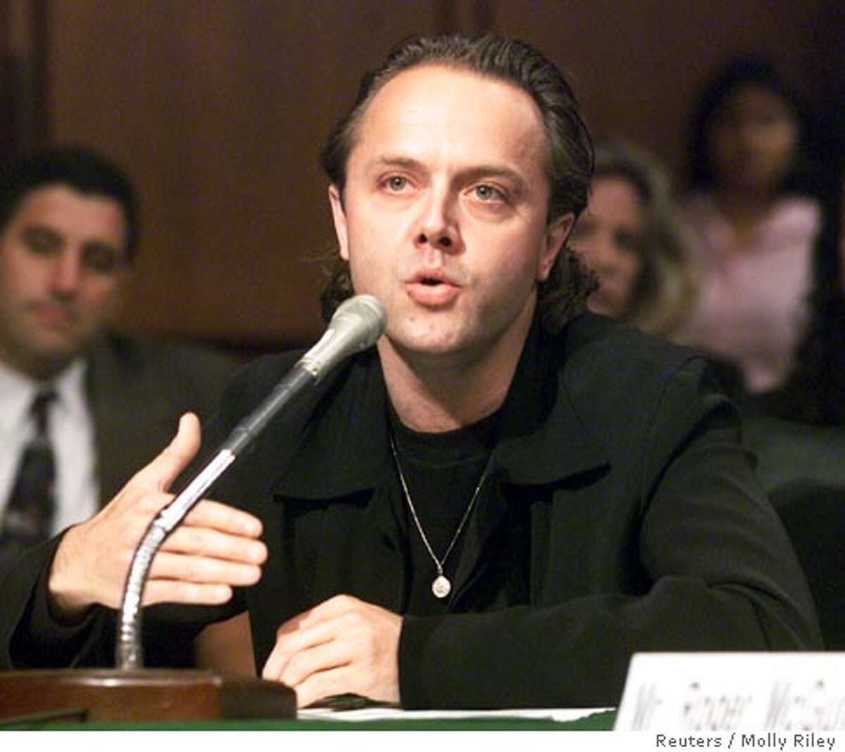 WAS11D:TECH-NAPSTER:WASHINGTON,11JUL00 - Lars Ulrich, the drummer of Metallica, testifies before a Senate Judiciary committee in Washington on the future of digital music, July 11. The hearing was held to examine whether there is an upside to downloading digital music with a focus on Internet websites like MP3.com and 'file-exchange' programs such as Napster and Gnutella. Metallica is suing Napster on its own for copyright infringement. mmr/Photo by Molly Riley REUTERS Ran on: 10-05-2006 Lars Ulrich, who testified before a Senate committee in July on the future of digital music.