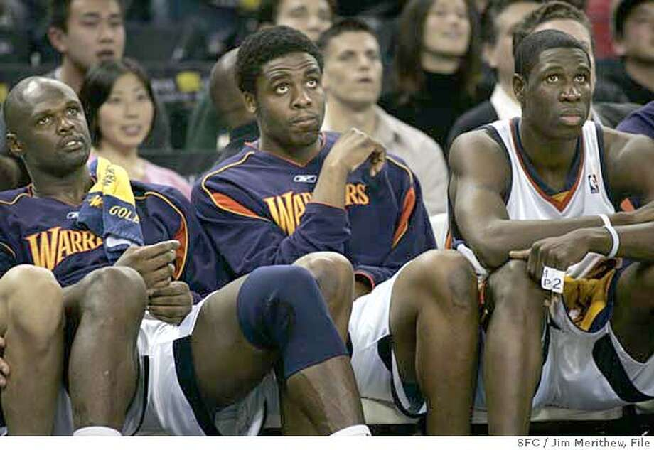 warriors_032806_jmerithew422.JPG  Warriors Adonal Foyle, Ike Diogu and Mickael Pietrus watch the closing minutes of the game from the bench. The Golden State Warriors lose to the Washington Wizard 98-116 at the Coliseum in Oakland, Ca Monday night March 27, 2006. JIM MERITHEW SFC MANDATORY CREDIT FOR PHOTOG AND SAN FRANCISCO CHRONICLE/ -MAGS OUT Photo: JIM MERITHEW