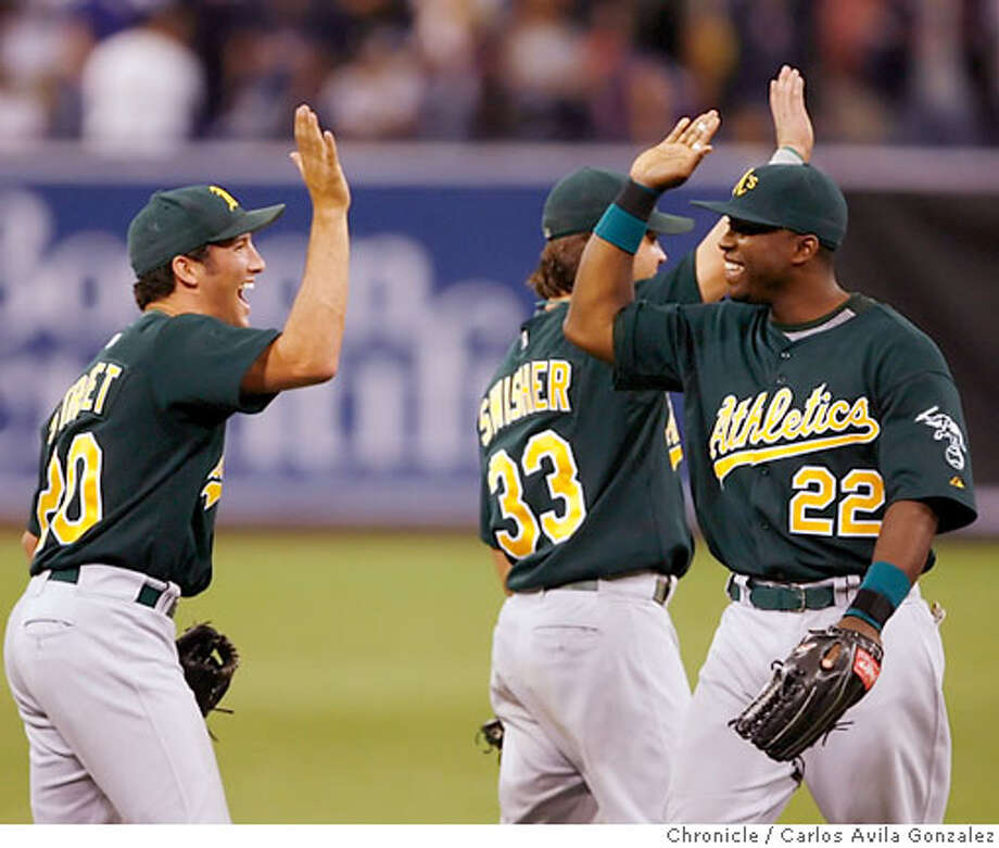 Huston Street high fives Milton Bradley after they defeated the Twins 3-2. The Oakland Athletics played the Minnesota Twins in Game 1 of the American League Division Series at the Metrodome in Minneapolis, Mn., on Tuesday October 3, 2006. Photo by Carlos Avila Gonzalez/The San Francisco Chronicle  Photo taken on 10/3/06, in Minneapolis, Mn, USA  **All names cq (source) Photo: Carlos Avila Gonzalez