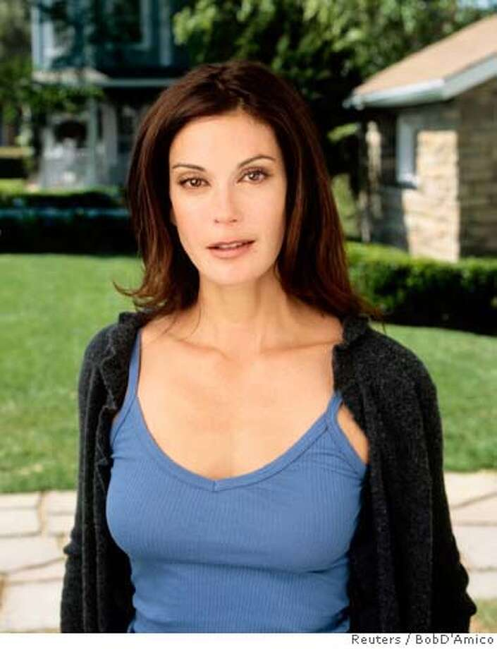 """Desperate Housewives"" star Teri Hatcher, who has been nominated for Best Actress in a Comedy Series for the 57th Annual Primetime Emmy Awards announced July 14, 2005, is seen in this undated handout photo. The Emmys will be awarded September 18, 2005. NO ARCHIVES REUTERS/BobD'Amico/ABC/Handout Ran on: 07-15-2005 Ran on: 07-15-2005 0 Photo: BobD'Amico/ABC/"