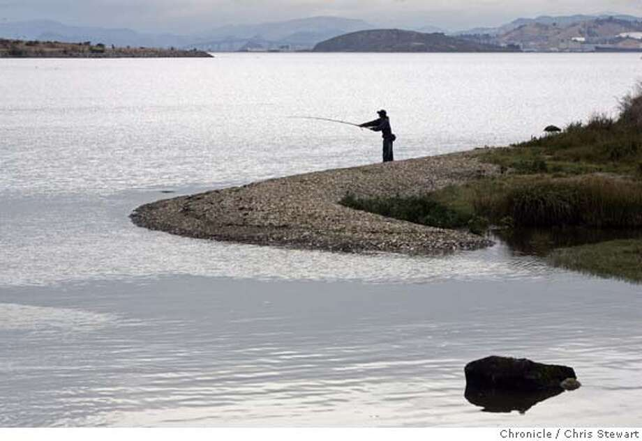 PARK05_024_cs.jpg  A fisherman casts his line along Berkeley Meadows prior to the official dedication today, October 4, 2006, of the new Eastshore State Park by the California Department of Parks and Recreation and the East Bay Regional Park District. The dedication took place at the newly-restored Berkeley Meadows section of the park. The 8.5 mile shoreline park stretches from the Bay Bridge to Richmond and includes 2,262 acres of uplands and tidelands along the waterfronts of Oakland, Emeryville, Berkeley, Albany and Richmond. The park was created after 25 years of citizens' activism. Chris Stewart / The Chronicle Eastshore State Park MANDATORY CREDIT FOR PHOTOG AND SF CHRONICLE/ -MAGS OUT Photo: Chris Stewart