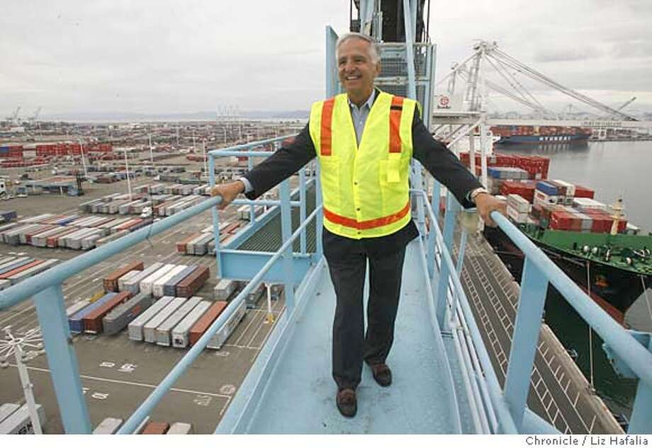 MAERSK05_010.JPG Gene Penitmonti, vice president of Maersk Line--a major shipping company--on a ship-to-shore crane at his berths at the Port of Oakland. In May the company announced it is switching to a less-polluting low-sulfer fuel on both the auxiliary and main engines of all the ships that call California. The ships switch from heavier bunker fuel to the cleaner fuel when 24 miles out of port, and they use that cleaner fuel while at port and when departing. cq--Gene Penitmonti . Liz Hafalia/The Chronicle MANDATORY CREDIT FOR PHOTOGRAPHER AND SAN FRANCISCO CHRONICLE/ -MAGS OUT Photo: Liz Hafalia