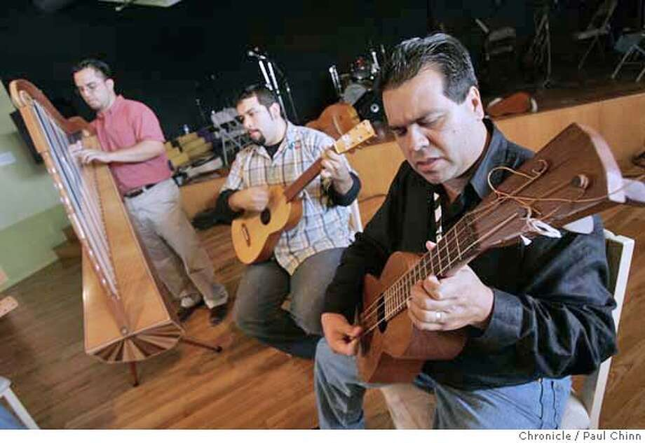 Eugene Rodriguez (foreground) and his music ensemble Los Cenzontles rehearse for a tour of Mexico in San Pablo, Calif. on Wednesday, Sept. 27, 2006. PAUL CHINN/The Chronicle  **Eugene Rodriguez, Fabiola Trujillo, Sage Baggott, Lucina Rodriguez, Angel Abundez, Hugo Arroyo centzoles06 MANDATORY CREDIT FOR PHOTOGRAPHER AND S.F. CHRONICLE/ - MAGS OUT Photo: PAUL CHINN