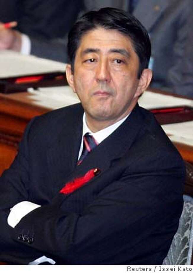 Japanese Prime Minister Shinzo Abe listens to a question during the Lower House plenary session at the parliament in Tokyo October 3, 2006. Abe, who took office last week, will visit China on October 8 and South Korea on October 9 for fence-mending summits, public broadcaster NHK said on Tuesday. REUTERS/Issei Kato (JAPAN) 0 Photo: ISSEI KATO