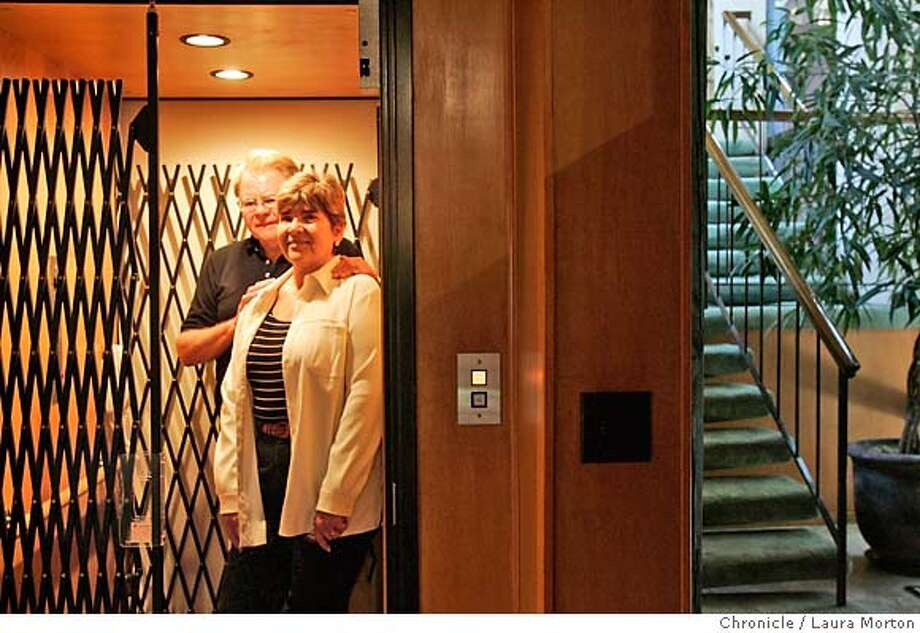 Rob and Susan Walker say the elevator in their Atherton home will allow them mobility. Chronicle photo by Laura Morton