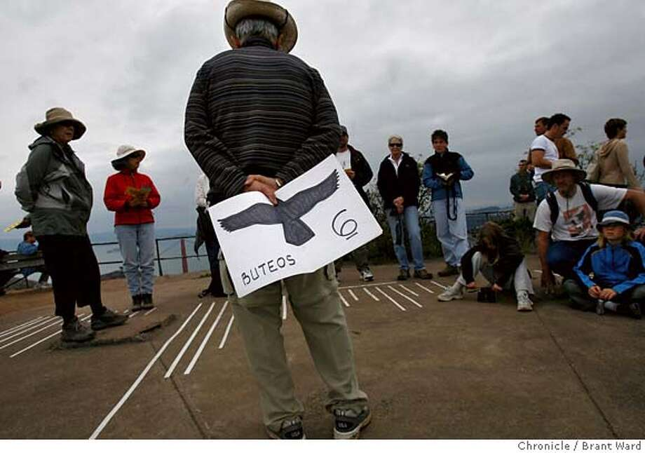 raptor002.jpg  Volunteer Charles Massen talks to dozens of people who have hiked up Hawk Hill to hear about the raptor migration. In his hand is a picture showing the wing configuration of one type of raptor.  The annual migration of raptors: hawks, eagles, falcons, going south over the wild scenic marin headlands. The Golden Gate Raptor Observatory use Hawk Hill, high above the Golden Gate bridge to count the raptors as they pass by overhead.  {Brant Ward/The Chronicle} 10/1/06 MANDATORY CREDIT FOR PHOTOGRAPHER AND SAN FRANCISCO CHRONICLE/ -MAGS OUT Photo: Brant Ward