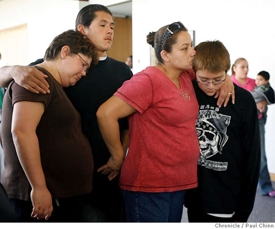 Family members of murdered Brinks guard Anthony Quintero, from left, Desiree Quintero-Rey, Jose Quintero, Janie Medina and Jose Medina console each other while they wait for the arraignment of Brinks armored car driver Clifton Wherry Jr. at Alameda County Superior Court in Oakland, Calif. on Tuesday, Oct. 3, 2006. Wherry is accused of killing his partner Anthony Quintero in a botched robbery attempt last week.  PAUL CHINN/The Chronicle  **Clifton Wherry Jr., Desiree Quintero-Rey, Jose Qunitero, Janie Medina, Jose Medina, Anthony Quintero Photo: PAUL CHINN