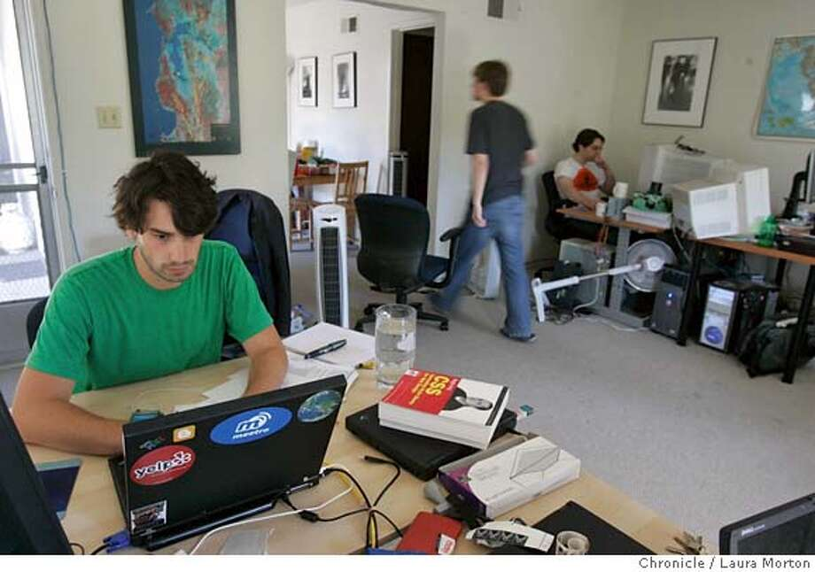 Livework5528_lkm.jpg Vincent Lauria (left) and Antonis Proios (right) work in the living room of the Palo Alto apartment where the employees of meetro, a social networking start-up company, work and live. They've converted the living room into an office, although one work station is in the kitchen. Laura Morton/The Chronicle MANDATORY CREDIT FOR PHOTOGRAPHER AND SAN FRANCISCO CHRONICLE/ -MAGS OUT Photo: Laura Morton