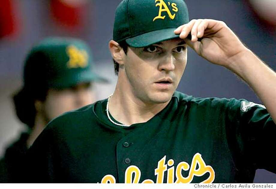 ATHLETICS-ALDS1_033_CAG.JPG  Barry Zito tips his hat to Mark Kotsay after a catch that ended the Twins's third inning. The Oakland Athletics played the Minnesota Twins in Game 1 of the American League Division Series at the Metrodome in Minneapolis, Mn., on Tuesday October 3, 2006. Photo by Carlos Avila Gonzalez/The San Francisco Chronicle  Photo taken on 10/3/06, in Minneapolis, Mn, USA  **All names cq (source)  Ran on: 10-04-2006  Frank Thomas accepts congratulations from coach Ron Washington as he rounds third after his second home run in the Game 1 win.  Ran on: 10-04-2006  Frank Thomas accepts congratulations from coach Ron Washington as he rounds third after his second home run in the Game 1 win. Photo: Carlos Avila Gonzalez