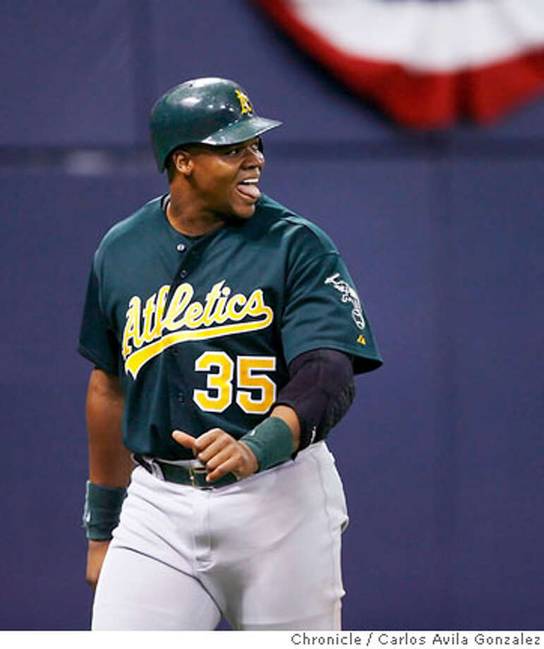 Athletics's Frank Thomas makes a face as Mark Ellis pops out in the top of the seventh inning leaving the bases loaded. The Oakland Athletics played the Minnesota Twins in Game 1 of the American League Division Series at the Metrodome in Minneapolis, Mn., on Tuesday October 3, 2006. Photo by Carlos Avila Gonzalez/The San Francisco Chronicle  Photo taken on 10/3/06, in Minneapolis, Mn, USA  **All names cq (source) Photo: Carlos Avila Gonzalez