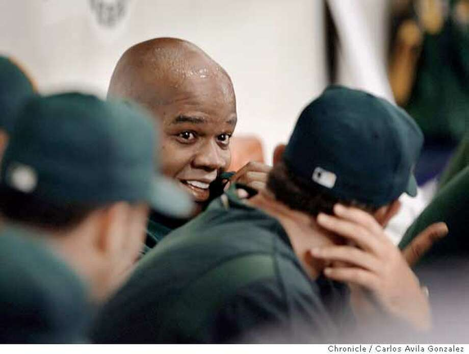 ATHLETICS-ALDS1_044_CAG.JPG  Athletics's Frank Thomas smiles in the dugout with teammates after hitting his second homerun of the game in the top of the ninth inning. It was his second solo homerun and the game winning run. The Oakland Athletics played the Minnesota Twins in Game 1 of the American League Division Series at the Metrodome in Minneapolis, Mn., on Tuesday October 3, 2006. Photo by Carlos Avila Gonzalez/The San Francisco Chronicle  Photo taken on 10/3/06, in Minneapolis, Mn, USA  **All names cq (source)  Ran on: 10-04-2006  Frank Thomas shows the winning look after hitting his second home run in the Game 1 victory over the Twins.  Ran on: 10-04-2006  Frank Thomas shows the winning look after hitting his second home run in the Game 1 victory over the Twins. Photo: Carlos Avila Gonzalez