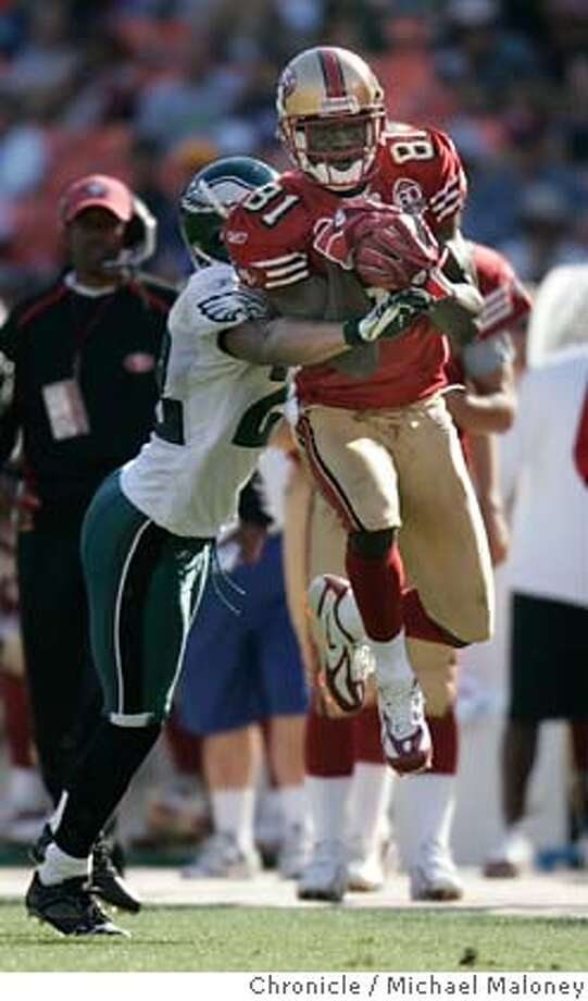 49ers Antonio Bryant (#81) grabs a 4th quarter pass from Alex Smith, Eagles Joselio Hanson covering.  San Francisco 49ers vs Phiadelphia Eagles at Monster Park.  Photo by Michael Maloney / San Francisco Chronicle on 9/24/06 in San Francisco,CA MANDATORY CREDIT FOR PHOTOG AND SF CHRONICLE/ -MAGS OUT Photo: Michael Maloney