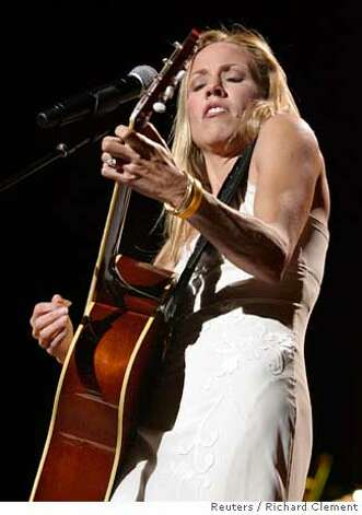 "Sheryl Crow performs on the opening night of her Wildflower Tour in Seattle October 16, 2005. The tour highlights her fifth studio album ""Wildflower."" REUTERS/Richard Clement Ran on: 10-21-2005 Ran on: 10-21-2005 Ran on: 10-03-2006  Sheryl Crow's set made plain who, between her and co-headliner John Mayer, has the better material. Photo: RICHARD CLEMENT"