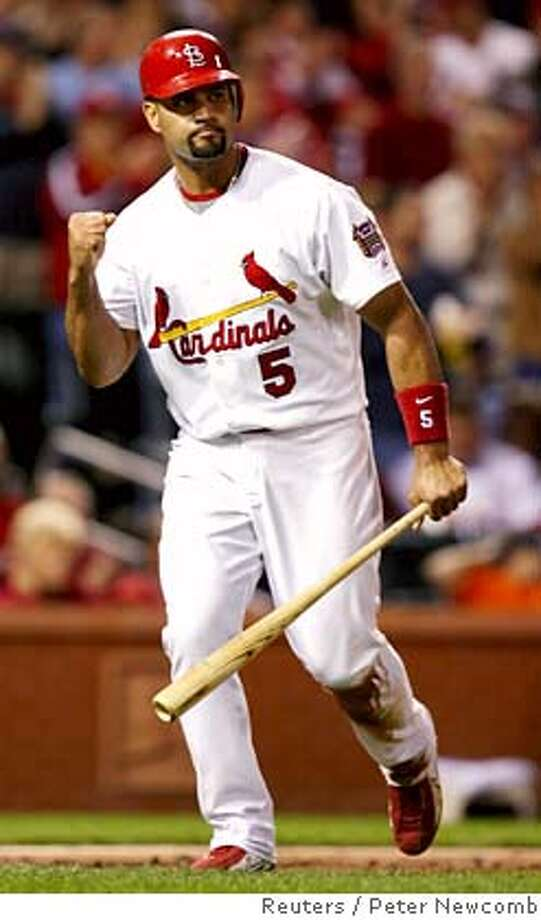 St. Louis Cardinals Albert Pujols celebrates after scoring a run in the fourth inning against the San Diego Padres in the National League game in St. Louis, Missouri, September 27, 2006. REUTERS/Peter Newcomb (UNITED STATES) Photo: PETER NEWCOMB