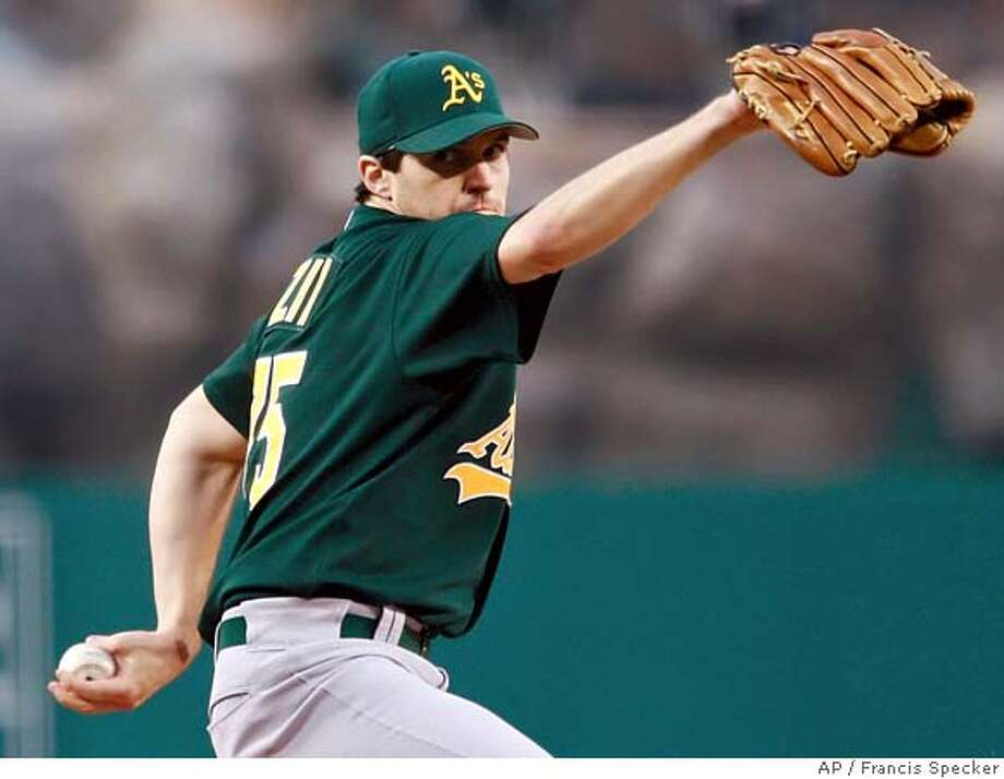 Oakland Athletics' Barry Zito pitches against the Los Angeles Angels during the first inning of a baseball game in Anaheim, Calif. on Monday, May 1, 2006. (AP Photo/Francis Specker)  Ran on: 05-02-2006  Barry Zito gave up five singles and two walks in 72-3 innings. EFE OUT Photo: FRANCIS SPECKER