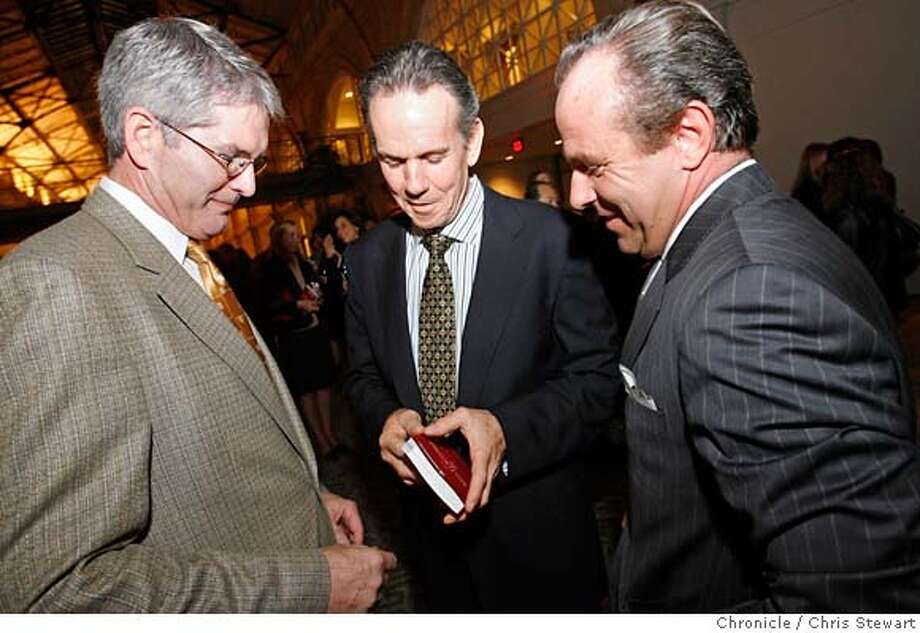 michelin_163_cs.jpg  Michael Ian Fanning (left), vice-president of corporate affairs for Michelin North America, Inc., famed Napa Valley chef Thomas Keller (center), winner of three Michelin stars, and Jean-Luc Naret (right), director of the Michelin Guide, look for Keller's rating in the guide at the unveiling tonight, October 2, 1006, of the San Francisco Bay Area & Wine Country Michelin Guide in the Grand Hall of the Ferry Building in San Francisco, California. It is the first-ever restaurant and hotel Guide for the West Coast. Chris Stewart / The Chronicle Michelin, Thomas Keller MANDATORY CREDIT FOR PHOTOG AND SF CHRONICLE/ -MAGS OUT Photo: Chris Stewart