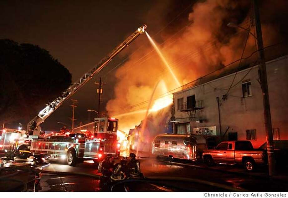 Oakland firefighters battle a five-alarm fire that devoured a warehouse in the Fruitvale district early Monday morning, October 2, 2006. Photo by Carlos Avila Gonzalez/The San Francisco Chronicle  Photo taken on 10/2/06, in Oakland, Ca, USA  **All names cq (source) Photo: Carlos Avila Gonzalez