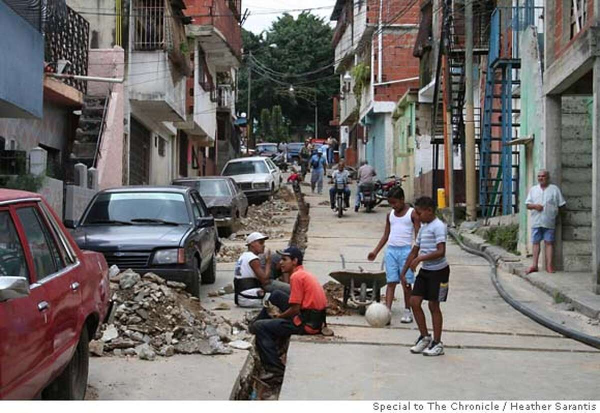 Workers take a break from building a waterline in the San Juan barrio in Caracas. This is part of a multi-billion-dollar initiative by the Chavez administration to help local residents elect neighborhood authorities and give them resources for local projects. Photo by Heather Sarantis/Special to The Chronicle