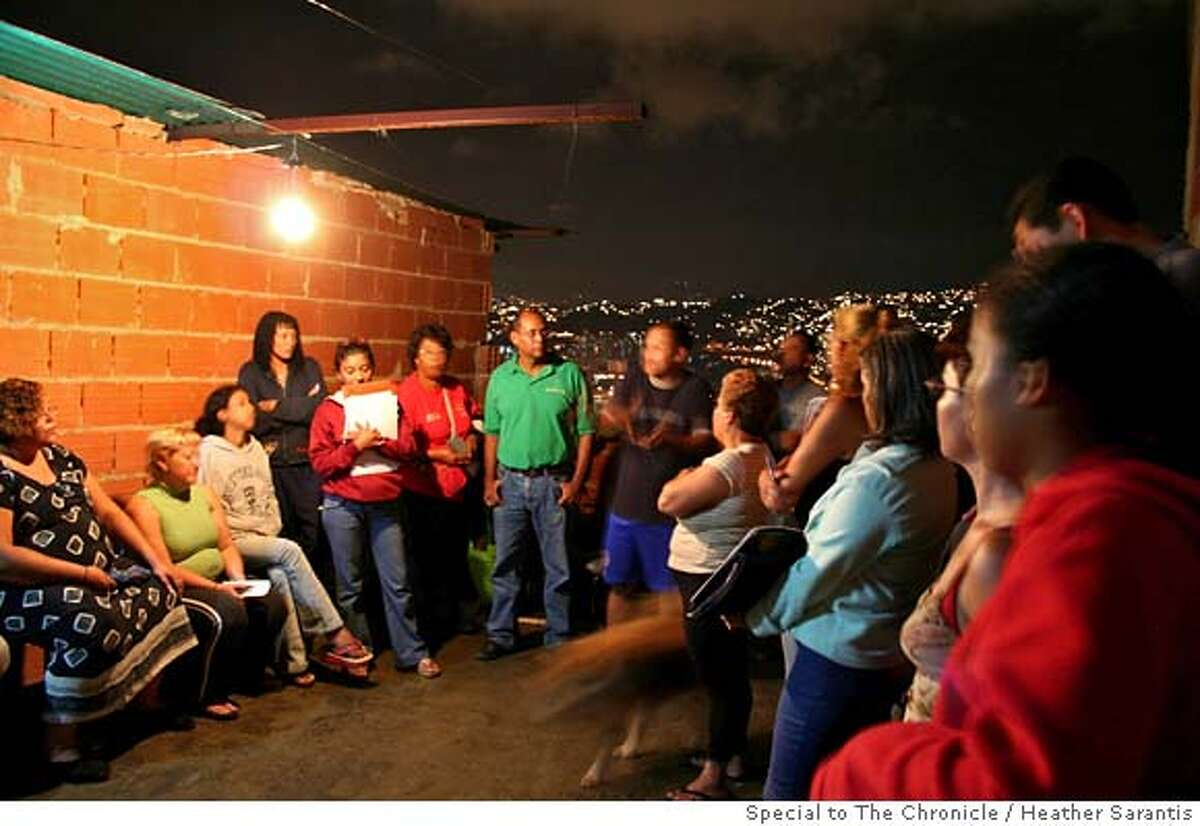 Members of the newly elected communal council in the San Juan neighborhood of Caracas meet on a rooftop to discuss plans for better services and more rights. Communal councils have been created all over the country and are being given lavish budgets by the government. Photo by Heather Sarantis/Special to The Chronicle