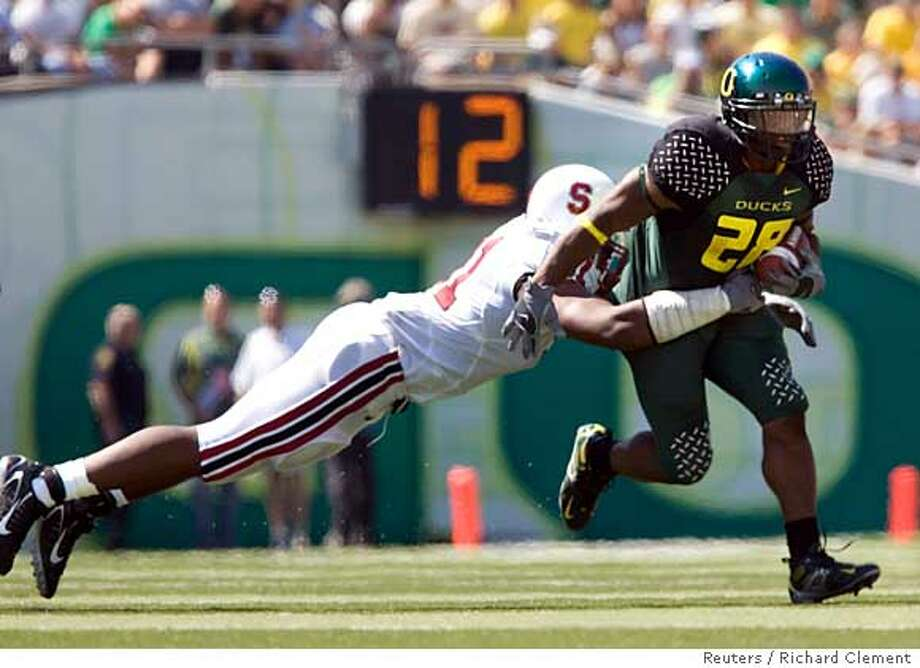 University of Oregon running back Jonathon Stewart (28) runs past University of Stanford's Pannel Egboh (91) in the second quarter of their NCAA football game in Eugene, Oregon, September 2, 2006. REUTERS/Richard Clement (UNITED STATES)  Ran on: 09-07-2006  Pannel Egboh stretches out to get ahold of Oregon running back Jonathan Stewart in Stanford's loss at Eugene on Saturday.  Ran on: 09-07-2006  Pannel Egboh stretches out to get ahold of Oregon running back Jonathan Stewart in Stanford's loss at Eugene on Saturday.  Ran on: 10-02-2006  Jonathan Stewart and the rest of the high-powered Oregon offense come to Berkeley on Saturday. Stewart has run for more than 100 yards in three of the Ducks' games this season. Photo: RICHARD CLEMENT