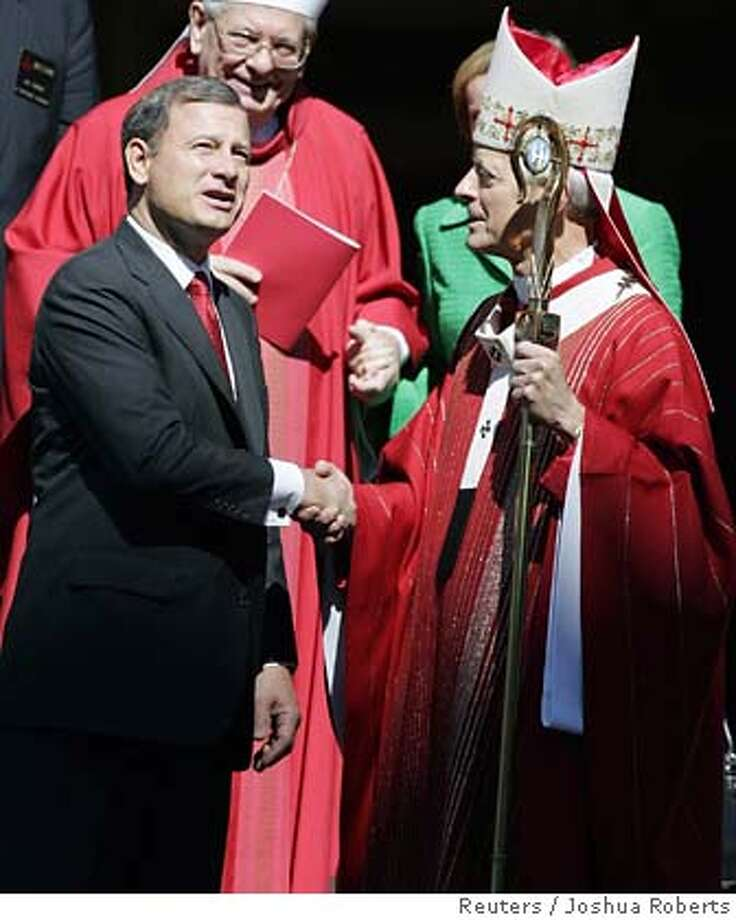 Supreme Court Chief Justice John Roberts (L) speaks with Archbishop of Washington Donald Wuerl (R) after the Red Mass at St. Matthews Cathedral in Washington October 1, 2006. The Red Mass is traditionally celebrated on the Sunday before the opening of the Supreme Court term. REUTERS/Joshua Roberts (UNITED STATES) 0 Photo: JOSHUA ROBERTS