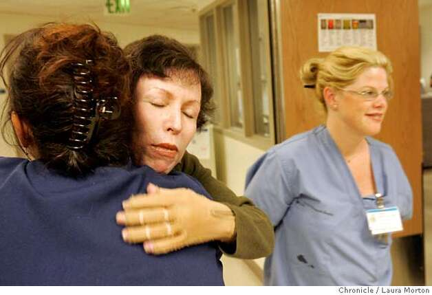 Lisa Nash gets a hug from Ramona Sollerborn, RN, after meeting her for the first time about a year after Sollerborn helped saved Nash's life. Sollerborn was one of the nurses on duty in the emergency room at St. Francis Hospital the day Nash was rushed to the hospital after a PG&E transformer blew up underneath her when she was walking down Kearny St. in San Francisco, CA. MANDATORY CREDIT FOR PHOTOGRAPHER AND SAN FRANCISCO CHRONICLE/ -MAGS OUT Photo: Laura Morton