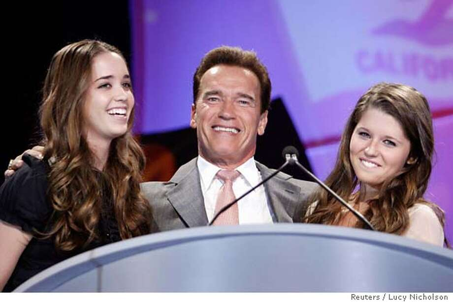 California Governor Arnold Schwarzenegger (C) hugs his daughters Katherine (L) and Christina as he introduces the 2006 California Governor & First Lady's Conference on Women in Long Beach, California, September 26, 2006. REUTERS/Lucy Nicholson (UNITED STATES)  Ran on: 09-30-2006  Schwarzenegger  Ran on: 10-02-2006  Gov. Arnold Schwarzenegger and the Legislature seek to improve school, highway and flood control systems. Photo: LUCY NICHOLSON