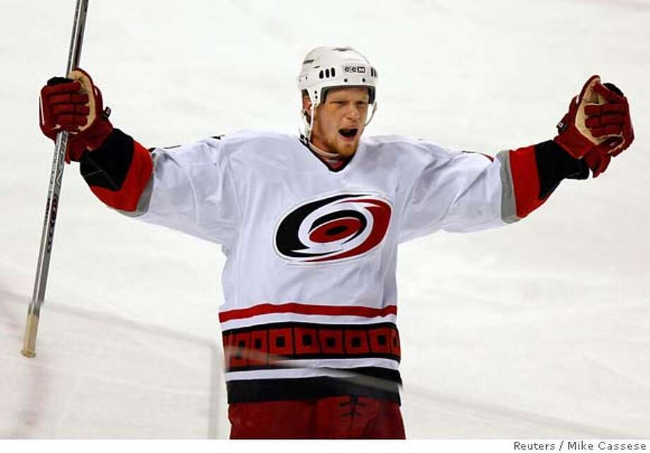 Carolina Hurricanes Eric Staal celebrates his goal during the first period of Game 4 of the NHL Eastern Conference final against the Buffalo Sabres in Buffalo, New York, May 26, 2006. REUTERS/Mike Cassese  Ran on: 05-27-2006 Ran on: 05-27-2006 Ran on: 05-27-2006 Ran on: 05-28-2006  Eric Staal has had a lot to celebrate after scoring in 14 straight playoff games for the Hurricanes. 0 Photo: MIKE CASSESE