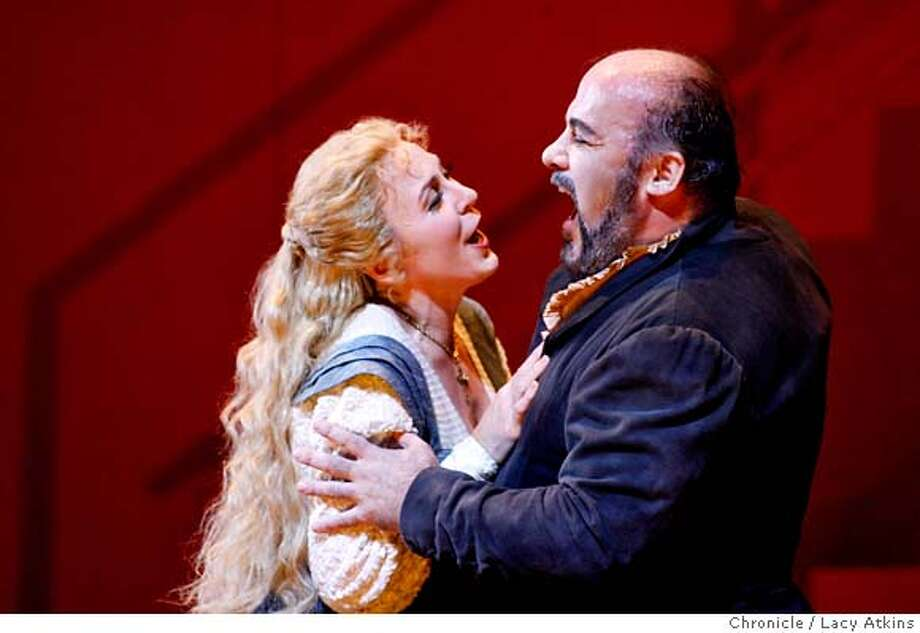 Mary Dunleavy as Glida and Paolo Gavanelli as Rigoletto during SF Opera performance of Verdi's great tragedy, Rigoletto during the dress rehearsal Sept. 27, 2006, in San Francisco, Ca. a  (Lacy Atkins/The Chronicle) MANDATORY CREDITFOR PHOTGRAPHER AND SAN FRANCISCO CHRONICLE/ -MAGS OUT Photo: Lacy Atkins