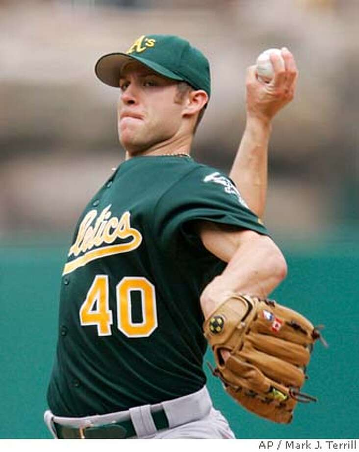 Oakland Athletics pitcher Rich Harden throws during the third inning of a baseball game against the Los Angeles Angels Sunday, Oct. 1, 2006, in Anaheim, Calif. (AP Photo/Mark J. Terrill) Photo: MARK J. TERRILL
