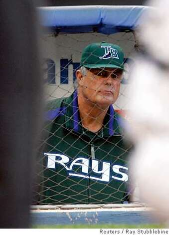 Tampa Bay Devil Rays manager Lou Piniella watches his team's game with the New York Yankees in the second inning of the game at Yankee Stadium in New York June 20, 2005. The former Yankees manager is now managing the team with the worst record in the American League, but the Devil Rays beat the Yankees 5-4 to end the Yanks' six-game winning streak. REUTERS/Ray Stubblebine Ran on: 06-21-2005  Lou Piniella says &quo;the lure and challenge (of getting) better&quo; is why he will honor the remainder of his contract with Tampa Bay. Photo: RAY STUBBLEBINE