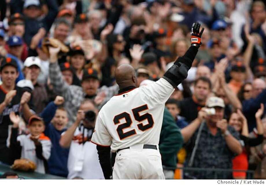 San Francisco Giants Barry Bonds comes back on the field after cheers from the fans to wave goodbye after hitting a double on his final at bat for the 2006 season during the 6th inning of the game against thee Los Angeles Dodgers at AT&T Park Sunday October 1, 2006 . Kat Wade/The Chronicle Photo: Kat Wade