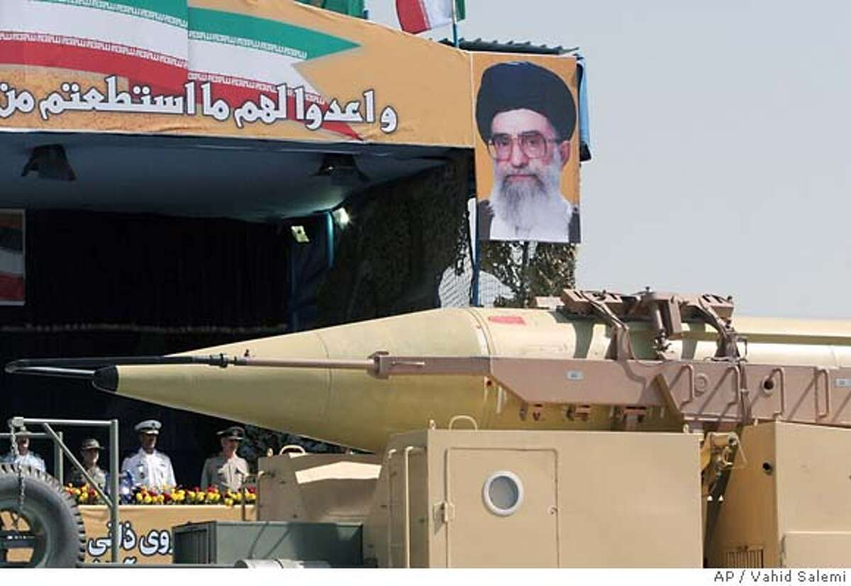 In front of a picture of supreme leader, Ayatollah Ali Khamenei, Iran's Shahab-3 missile, a weapon capable of carrying a nuclear warhead and reaching Europe, Israel and U.S. forces in the Middle East, is displayed during a parade ceremony, marking 26th anniversary of the outset of the Iran-Iraq war (1980-1988), in front of the mausoleum of the late revolutionary founder Ayatollah Ruhollah Khomeini, just outside Tehran, Iran, Friday, Sept. 22, 2006. (AP Photo/Vahid Salemi)