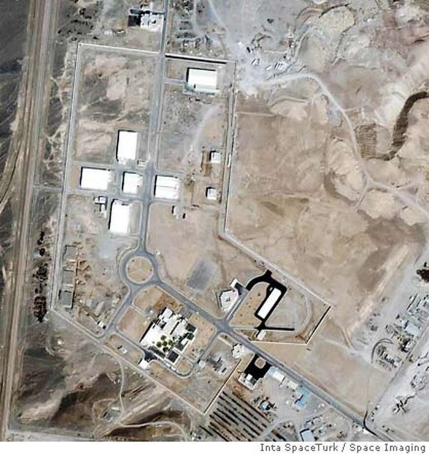 ** FILE ** This recent undated satellite image provided by Space Imaging/Inta SpaceTurk shows the once-secret Natanz nuclear complex in Natanz, Iran, about 150 miles south of Tehran. Iran broke U.N. seals on its nuclear enrichment facility Tuesday, Jan. 10, 2006 pledging only to conduct research, but the international nuclear watchdog said Tehran also planned small-scale enrichment of uranium _ a process that can produce fuel for nuclear weapons. (AP Photo/Space Imaging/Inta SpaceTurk, HO) Ran on: 01-11-2006  A recent satellite image shows the once-secret Natanz nuclear complex in Natanz, Iran, about 150 miles south of Tehran. Ran on: 01-11-2006  A recent satellite image shows the once-secret Natanz nuclear complex in Natanz, Iran, about 150 miles south of Tehran.Ran on: 03-25-2006  This satellite image shows the Iranian nuclear complex in Natanz, about 150 miles south of the capital, Tehran. Diplomats say Iran has foregone usual testing periods for individual centrifuges, instead appearing to be trying to put together as many as possible. SATELLITE PHOTO PROVIDED BY SPACE IMAGING/ INTA SPACETURK ** MANADATORY CREDIT ** Photo: X