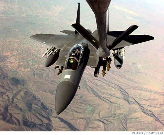 Air strikes would likely require midflight refueling by a KC-135R Stratotanker, shown above refilling an F-15E Strike Eagle. Reuters file photo, 1999, by Scott Reed