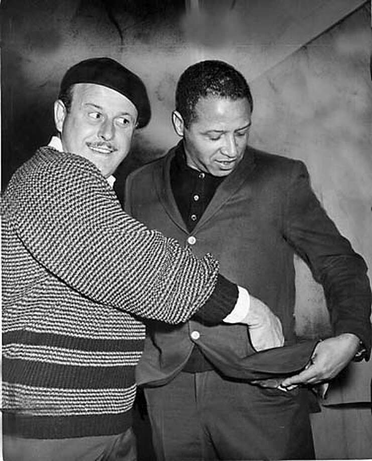 BANDUCCI-16MAY61-YOUNG - Enrico Banducci picking the picking the pockets of Stan Wilson. Banducci trying to get back the money loaned to Wilson. Photo by Bill Young Photo: BILL YOUNG