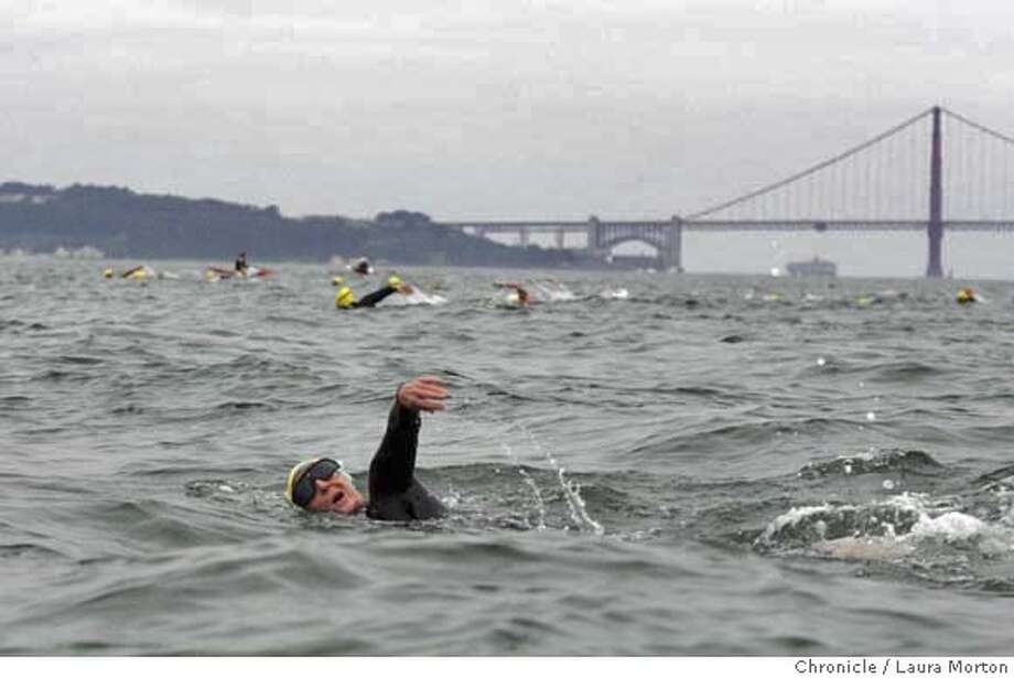 Participants in the South End Rowing Club Alcatraz Invitational Swim make their way towards Fisherman's Wharf after jumping off a boat off the coast of Alcatraz into the Bay. This is the 11th year of the annual event. **** Couldn't get this woman's name - number isn't visible. MANDATORY CREDIT FOR PHOTOGRAPHER AND SAN FRANCISCO CHRONICLE/ -MAGS OUT Photo: Laura Morton