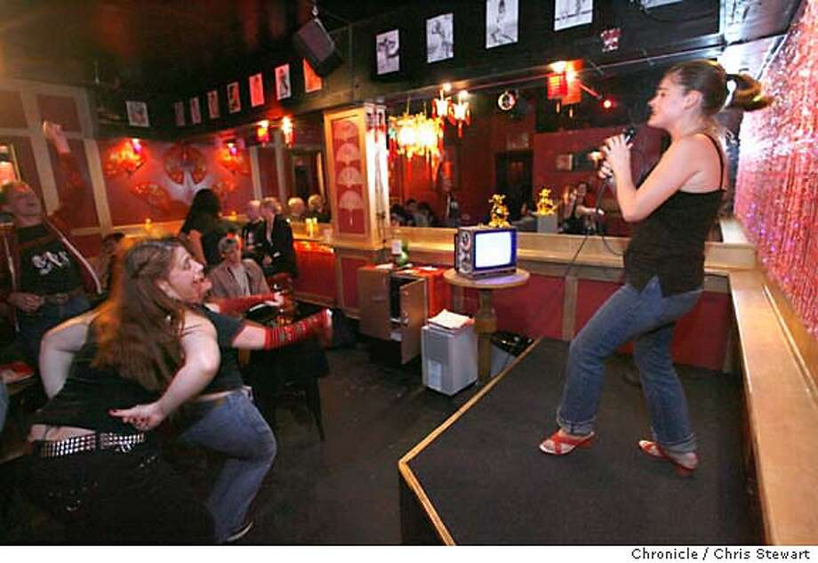 """GAMES01_112_cs.jpg Event on 9/11/06 in San Francisco. Jody Handley, 31, of SF, sings """"Wham Rap"""" before an enthusiastic crowd at the mike for Punk Rock 'n' Schlock Karaoke at Annie's Social Club, 917 Folsom Street, SF.  (415) 974-0518 punkrocknschlock@beanersprout.com Chris Stewart / The Chronicle Annie's Social Club, karaoke MANDATORY CREDIT FOR PHOTOG AND SF CHRONICLE/ -MAGS OUT Photo: Chris Stewart"""