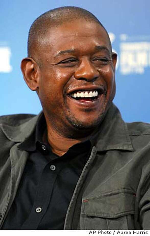 "Forest Whitaker laughs at a press conference for ""The Last King of Scotland"" during the Toronto International Film Festival in Toronto Monday, Sept. 11, 2006. (AP Photo/CP .Aaron Harris) Photo: AARON HARRIS"