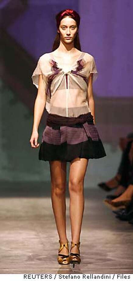A model displays an outfit as part of Prada's Spring/Summer 2007 women's collections during Milan Fashion Week in this September 26, 2006 file photo. To match WITNESS-FASHION REUTERS/Stefano Rellandini/Files (ITALY) 0 Photo: STEFANO RELLANDINI